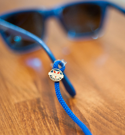6775ccd565 Keep your spiffy vintage shades from getting lost on the hills with a set  of straps by Vuarnet. Each piece is made with a durable cotton nylon cord  with the ...